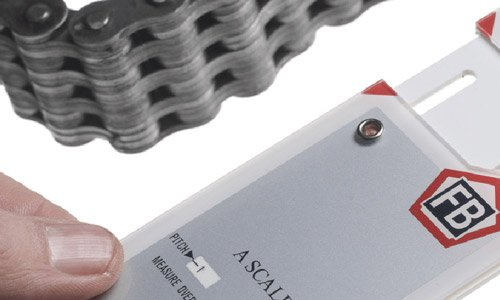 Why use a professional chain wear gauge over tape or steel rule?